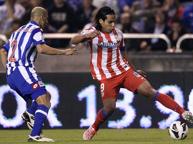 Deportivo Coruna's Manuel Pablo battles for the ball with Atletico Madrid's Falcao during their Spanish First Division soccer match at the Riazor stadium in Coruna